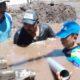 DIPERBAIKI: Petugas PDAM Tirta Baluran Situbondo sedang memperbaiki pipa saluran air yang bocor. (imam)