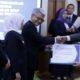 TERIMA PENGHARGAAN: Wakil Bupati Situbondo H Yoyok Mulyadi M Si saat menerima penghargaan. (imam)